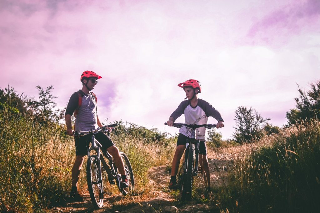 two boys on mountain bikes