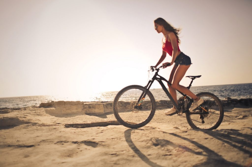 woman on a mountain bike in the sun